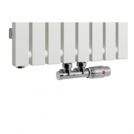 Zawór termostatyczny Multiflow chrom, figura kątowa prawa podłączony do grzejnika dekoracyjnego Advantage 180x39 w kolorze białym.